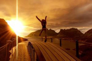 girl jumping on the mountains background