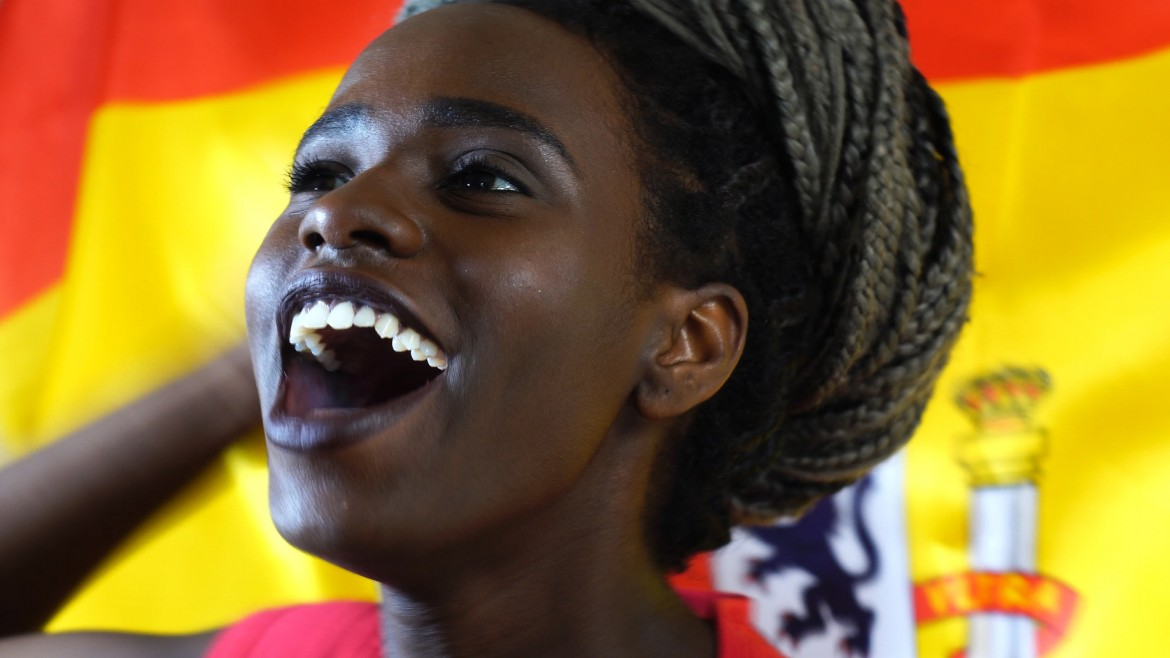Spanish Young Black Woman Celebrating with Spain Flag